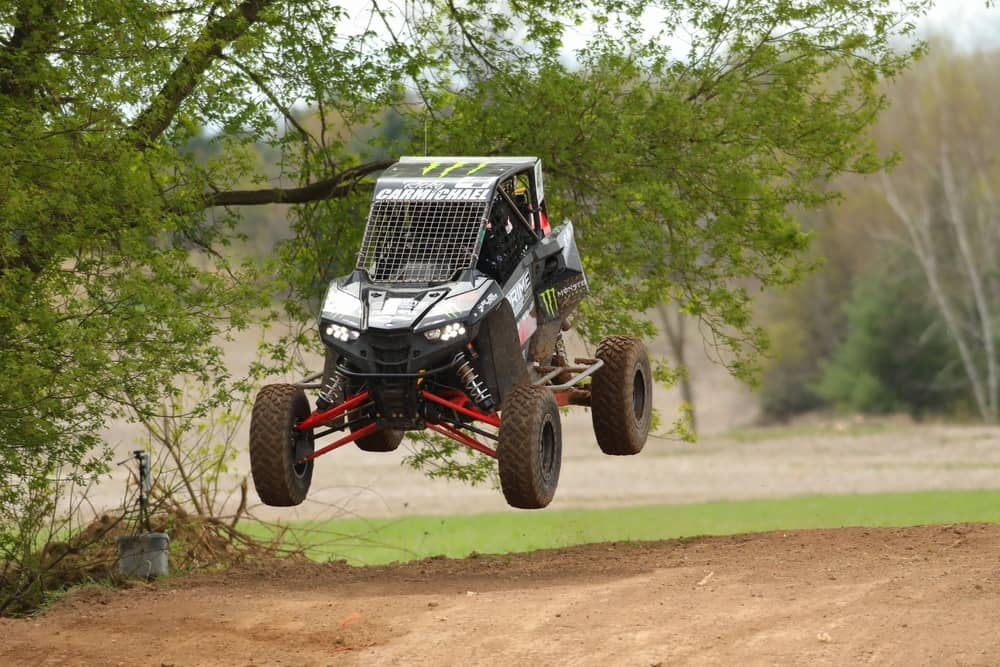 Ricky Carmichael getting some air while driving a Polaris during the SXS Sports Spring National Race at U.S. Air Motorsports Raceway