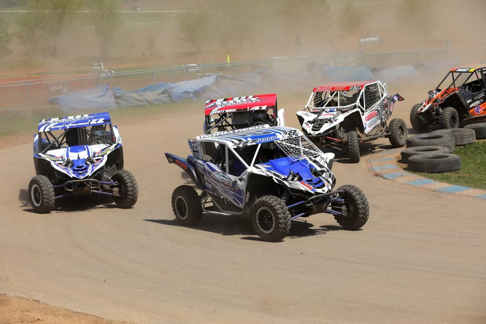 Five sxs's taking a turn on asphalt at U.S. Air Motorsports Raceway during the SXS Sports Spring National