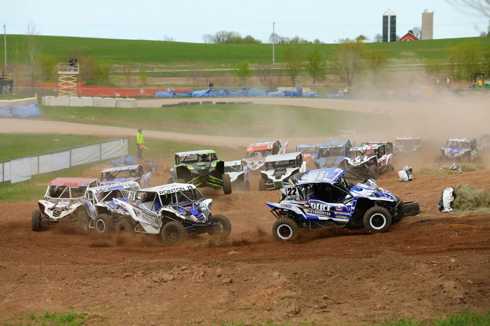 Racers taking a turn on dirt at the SXS Sports Spring National Race in Wisconsin