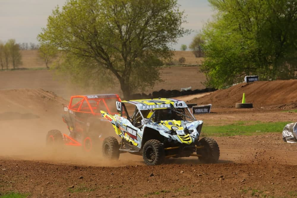 Yellow and gray yamaha racing in the SXS Sports Spring National in Shawano wisconsin