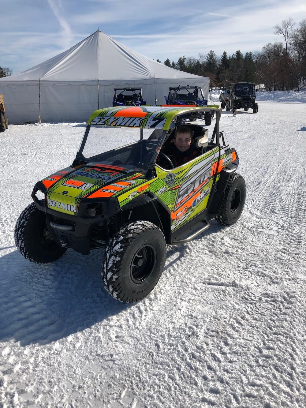 Neon yellow and orange mini Polaris getting ready for the Twin Bridge Takedown