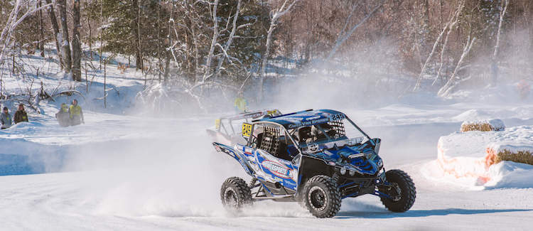 White and blue Yamaha taking a turn at the SXS Sports Twin Bridge Takedown in Crivitz Wisconsin